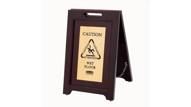 "Elegant, dark hardwood ""Caution"" Sign is 2-sided for effective multilingual safety communication that won't disrupt a building's image."